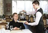 Waiter with a tray of food — Stock fotografie