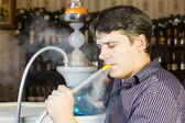 Man is smoking shisha — Foto Stock