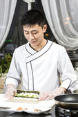 Japanese chef with a plate of sushi — Stock Photo