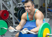 Young man training in the gym — Stock Photo