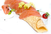 Eggs with cheese and salmon decorated with tomato — Stock Photo