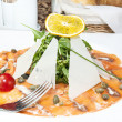 Stockfoto: Carpaccio of salmon meat with aruguland cheese