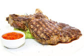 Grilling steak with tomato sauce beef beefsteak — ストック写真