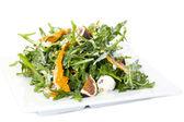 Salad of arugula ham cheese — Stock Photo