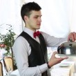 Stock video: Waiter with tray of food