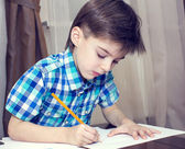 Children draw with crayons on paper — Stock Photo