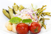 Pickled vegetables, cucumber tomatoes asparagus and garlic cabbage — Stock Photo