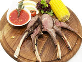 Grilled ribs with sauce and corn — Stock Photo