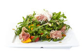 Salad of arugula figs and cheese — Stock Photo