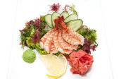 Japanese cuisine sashimi with vegetables and fish — Photo