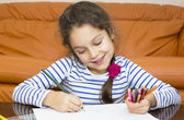 Children draw with crayons on paper — Stok fotoğraf