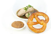 Sausages in beer sauce with mustard and pastries — Stock Photo