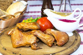 Chicken legs on a table — Stock Photo