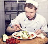 Chef preparing food in the kitchen — Stock Photo