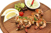 Grilled shrimp with a salad — Stock Photo