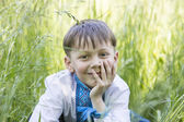 Boy on a summer nature — Stock Photo
