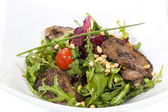 Rabbit liver salad with arugula — Stock Photo