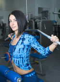 Young girl in the gym — Stock Photo