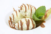 Balls of ice cream decorated with mint — Stock Photo