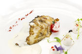 Roasted fillet of grilled fish in a white sauce — Stock Photo