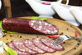 Sausages on a wooden plate — Stock Photo