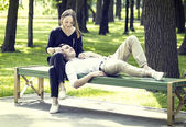 Young couple in park — Stock Photo