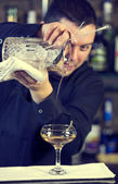 Young man working as a bartender — Stock Photo
