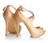 Ladies gold shoes — Stock Photo