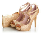 Ladies gold shoes and bag — Stock Photo