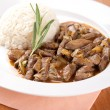 Pork liver with rosemary and rice — Stock Photo