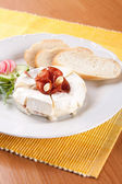 Camembert specialty with cream cheese and sausage — Stock Photo