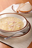 Potato soup with sausage and bread — Stockfoto