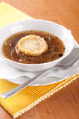 Onion soup with beef broth and bread — Stock Photo