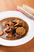 Beef goulash with fresh sliced mushrooms — Stockfoto