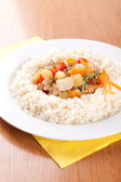 Pork with vegetables, garlic and rice — Photo