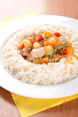 Pork with vegetables, garlic and rice — Stok fotoğraf