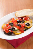 Zucchini salad with tomatoes and olives with bread — Stok fotoğraf
