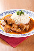 Fish goulash with rice and sauce — Stock Photo