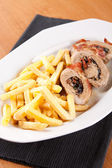 Pork fillet in foil with french fries — Stok fotoğraf