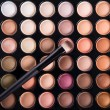 Palette of colorful eye shadows with brush — Stock Photo