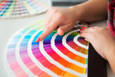 Graphic designer working with pantone palette — Stock Photo