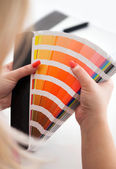 Graphic designer working with cmyk palette — Stock Photo