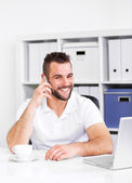 Happy business man talking on the phone — Stock Photo