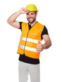 Portrait of smiling worker in a reflective vest — Stock fotografie