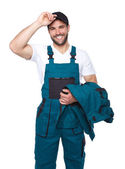 Portrait of smiling worker in green uniform — Stock Photo