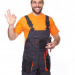 Portrait of a smiling worker in blue uniform holding pliers — Stock Photo #50447545
