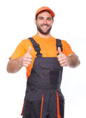 Portrait of smiling worker in blue uniform — Stock Photo
