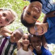 Children embracing in circle around the camera and smiling — Foto Stock