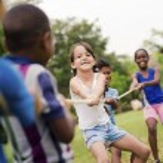 Group of happy multi ethnic school kids playing — Stock Photo #13885686