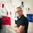 Portrait of happy man working as fashion designer - ストック写真